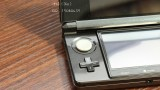 The analog stick and D-Pad. It has a much glossier, futuristic look than that of the DSi.